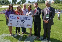 Check presentation at the 2014 Charity Bowl in Vienna, Austria.