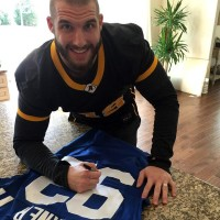 Indianapolis Colts linebacker Björn Werner signing a jersey that was donated to the Berlin Adler's crowdfunding campaign