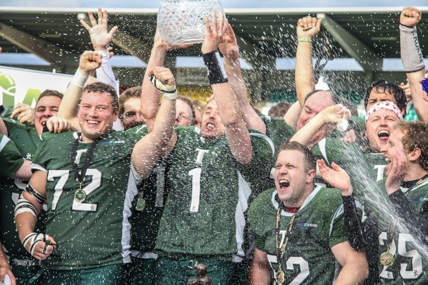 The Belfast Trojans hoist the Shamrock Bowl Trophy as national champions for the first of four times in as many years. No team has ever won five championships in a row.