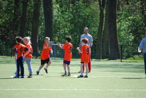 Ilja Tersteeg, founder of the Dominators, teaching flag football to children in Utrecht, Netherlands.